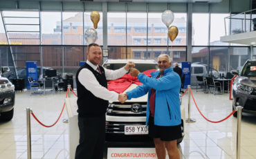 Lucky first prize winner Richard Holloway picking up the keys to his new Toyota Kluger AWD Grande 3.5-litre Petrol Auto Wagon.
