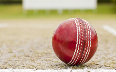cricket ball red stock image
